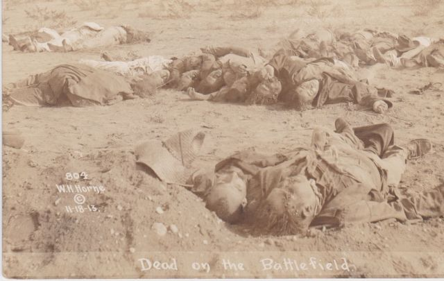 1913 Mexican Revolution real photo postcard showing dead on Battlefield. Photo by W. H. Horne of El Paso, Texas f